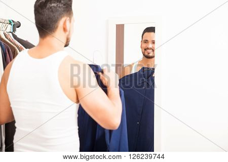 Attractive Man Trying A Shirt On