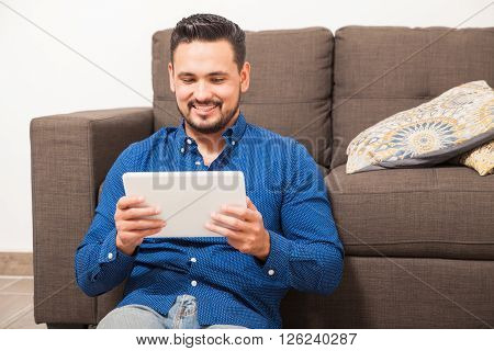 Man Watching Tv On A Tablet Computer