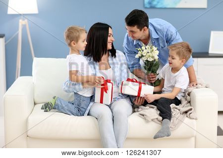 Family concept. Father with sons greeting mother, close up