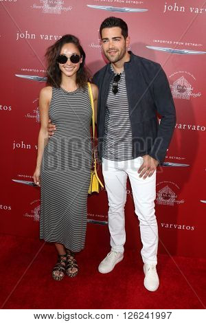 LAS VEGAS - APR 17:  Cara Santana, Jesse Metcalfe at the John Varvatos 13th Annual Stuart House Benefit at the John Varvatos Store on April 17, 2016 in West Hollywood, CA