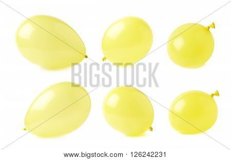 Inflated yellow air balloons isolated over the white background, set collection of six different foreshortenings