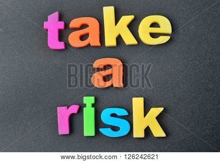 Take a risk words on black background