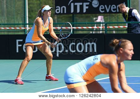 KYIV UKRAINE - APRIL 17 2016: Kateryna Bondarenko and Olga Savchuk of Ukraine in action during BNP Paribas FedCup World Group II Play-off pair game against Argentina at Campa Bucha Tennis Club