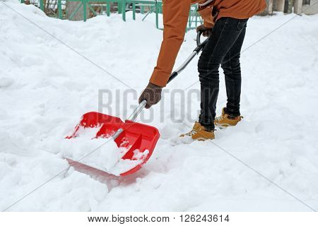 Man removing snow with a snow shovel