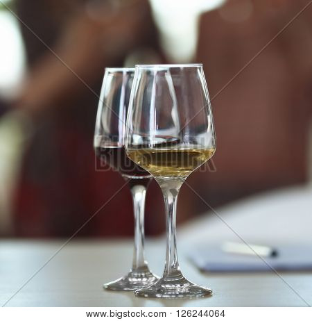 Two glasses of different wine on a table. Tasting wine concept