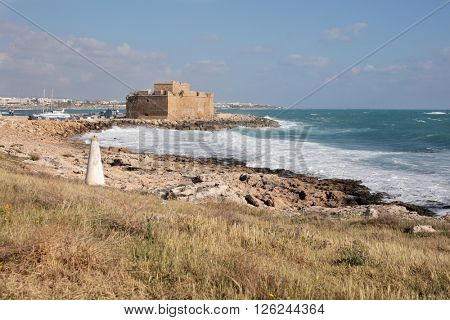 PAPHOS, CYPRUS - MARCH 16, 2016: View to the Paphos castle in a spring day. Medieval castle was declared a listed building in 1935 and represents one of the most distinctive landmarks of the city