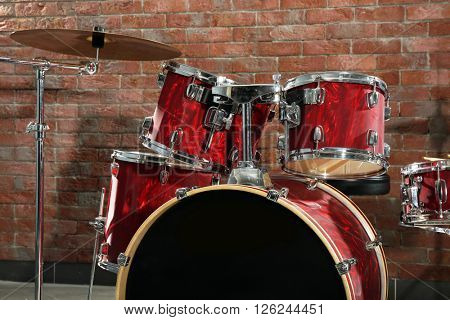Drum set on brick wall background
