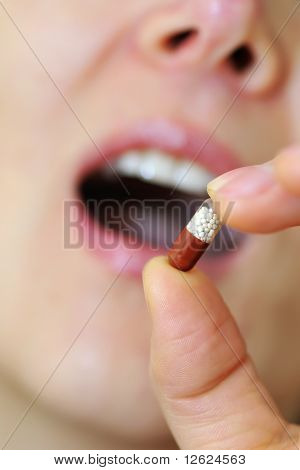 woman mouth with lips and medicine pill