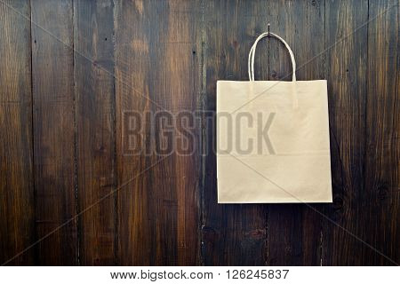 Paper pocket hanging on the wooden wall