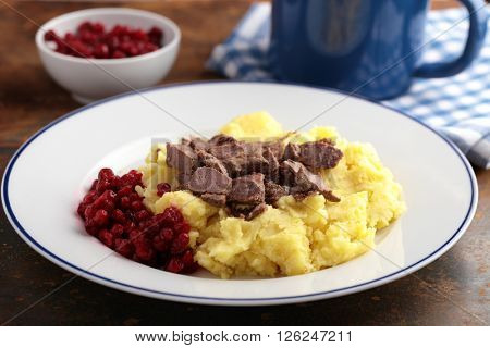 Venison with mashed potato and lingonberry sauce