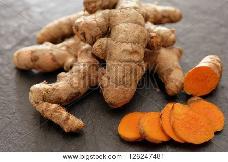 Turmeric rhizomes on a slate cutting board