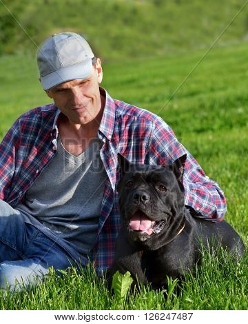 Man playing with his dog in the park