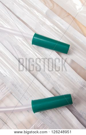 medical plastic catheters and syringes on table