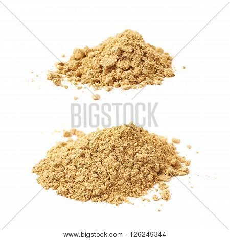 Pile of dry ginger cooking powder isolated over the white background, set of two different foreshortenings