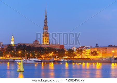 Saint Peter church, Stone Bridge and River Daugava in the Old Town of Riga at night, Latvia