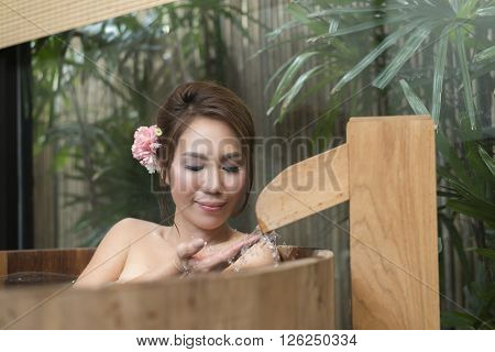 Onsen series : Asian woman in wooden bathtub