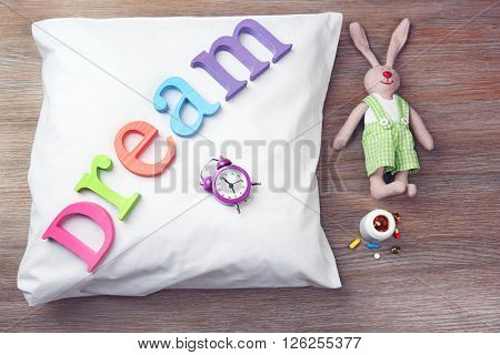 Word Dream on a white pillow