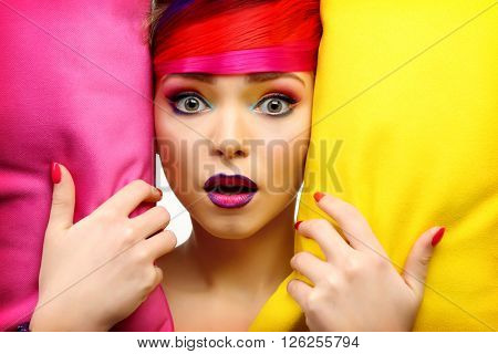 Beautiful girl with colorful makeup, manicure and hairstyle, close up