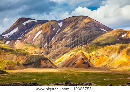 Magnificent Iceland in the summer. The valley of national park Landmannalaugar in warm sunlight of July