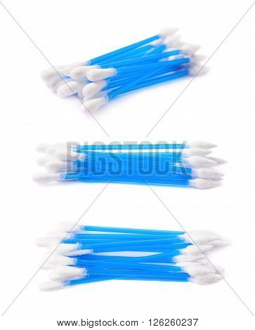 Pile of multiple blue cotton swabs buds isolated over the white background, set of three different foreshortenings