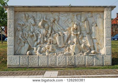 Roman and Dacian war fight scene on a relief in Carolina Citadel in Alba Iulia, Romania