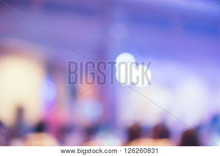 Blurred background Bokeh lighting in concert with audience Music showbiz concept vintage filtered image.