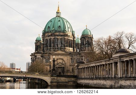 BERLIN, GERMANY - JANUARY 18 2016: Berlin Cathedral or Berliner Dom is the short name for the Evangelical Supreme Parish and Collegiate Church in Berlin Germany located on Museum Island in the Mitte borough.
