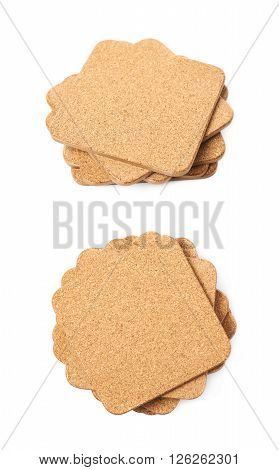 Pile of square cork textured drink's coasters isolated over the white background, set of two different foreshortenings