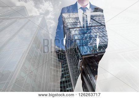Double exposure of businessman and modern skyscrapers. Concept background of business leader, career, investment etc.