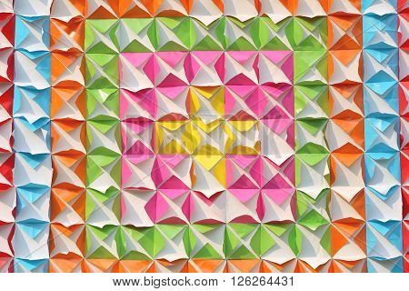 Artificial colorful paper a triangle and a square for design and decorate the background.