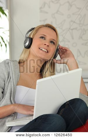 Portrait of a young woman smiling listening to music