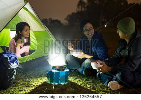 Freinds go camping at night