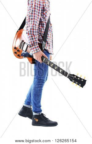 Young man in blue jeans going right with electric guitar, isolated on white