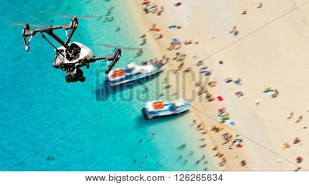 Drone for industrial works flying above beach
