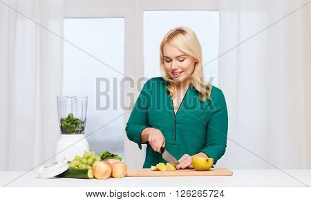 healthy eating, cooking, vegetarian food, diet and people concept - smiling young woman with blender and knife chopping fruits and vegetables on cutting board at home