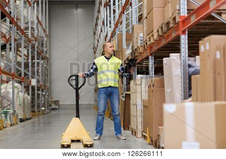 wholesale, logistic, loading, shipment and people concept - man with loader and clipboard at warehouse