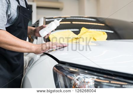 Car detailing series : Worker waxing white car