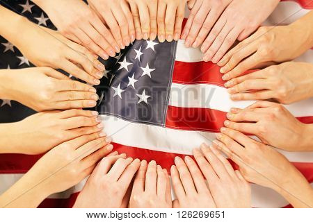 Group of fingers forming circle on USA National Flag background