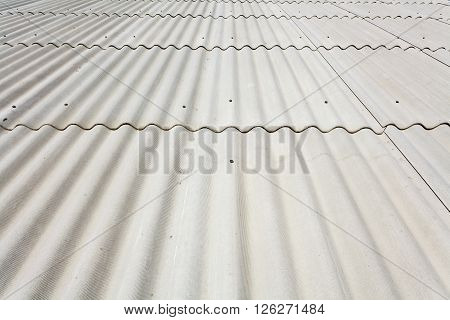 White line asbestos slate roof close up