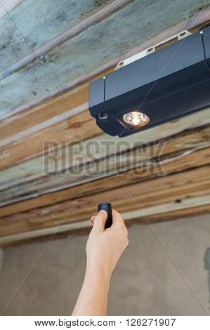 Garage doors installation. Contractor programming a mechanical garage door opener