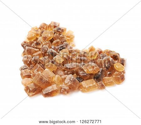 Heart shape made of large brown rock sugar crystals, composition isolated over the white background