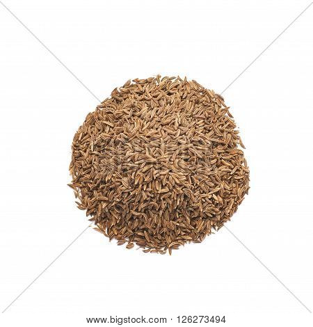 Pile of cumin seeds isolated over the white background