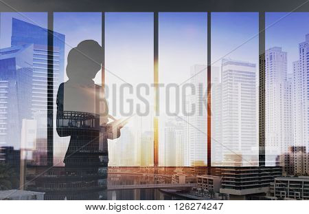 business and people concept - silhouette of woman with tablet pc over office window background over double exposure office and city background