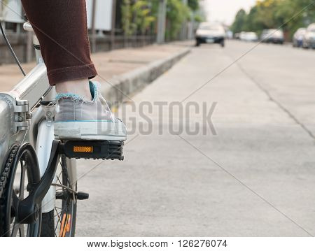 foot on pedal of bicycle ready for departure