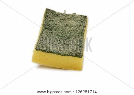 Worn out Srubber on the white background yellow sponge with scrubber