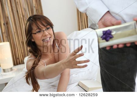 Man with a gift package for his wife