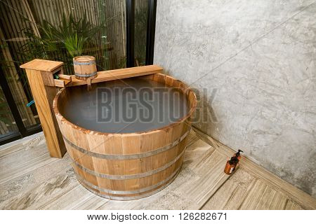 Onsen series : Wooden bathtub filled with mineral water