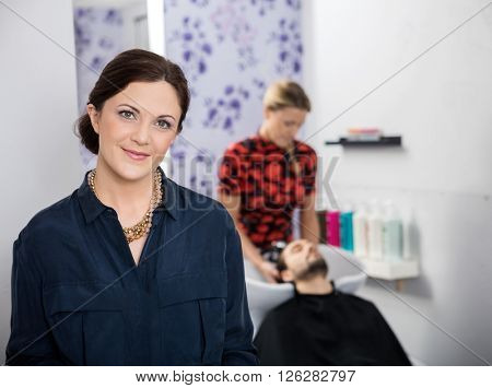 Portrait Of Beautiful Hairstylist In Salon