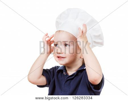 Portrait of little caucasian boy in the cook cap helps mum to cook a pizza. Closeup isolated on white background