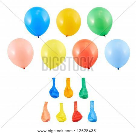 Set of inflated and deflated party air balloons isolated over white background